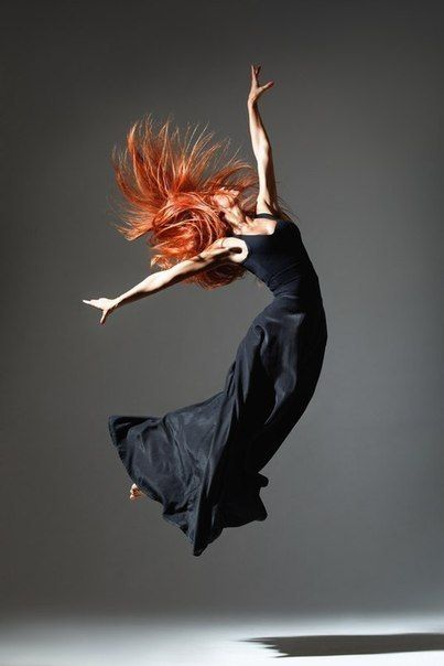 Ginger haired dancer in jump