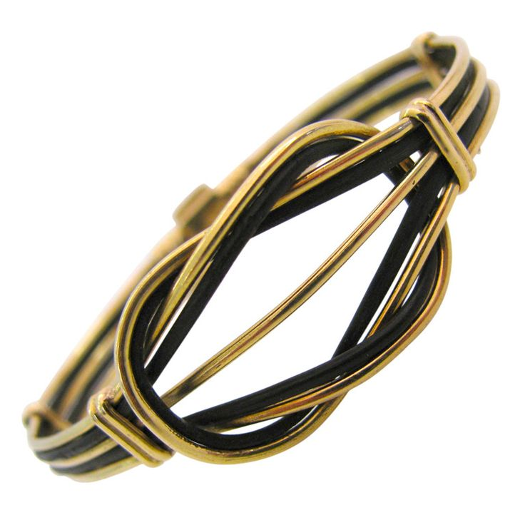 A Gold and Elephant Hair Love Knot Bracelet   From a unique collection of vintage bangles at https://www.1stdibs.com/jewelry/bracelets/bangles/