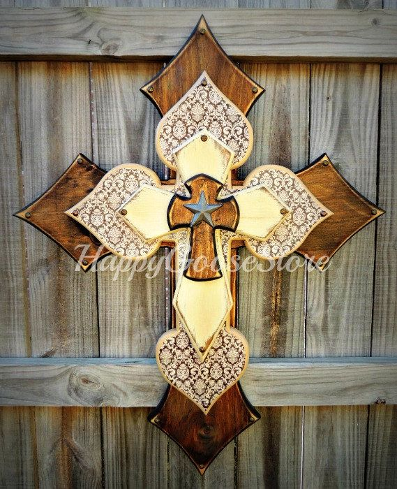 X-LARGE wooden wall CROSS in stain, brown damask, antiqued beige, and topped with an iron star. Goes beautifully with any decor!!  * measures 36 x 28 * light protective clear coat * comes ready to hang    ~~~~~~~~~~Please note:~~~~~~~~~~~~~~~~~~~~~~~~~~ ~~~~~~~~~~~~~~~~~~~~~~~~~~~~~~~~~~~~~~~~~~~~~~~~~ Crosses are not created until payment has been received. Orders may take up to 4 weeks to ship once you have paid, depending on our workload. Please send us a message if you would like a more…