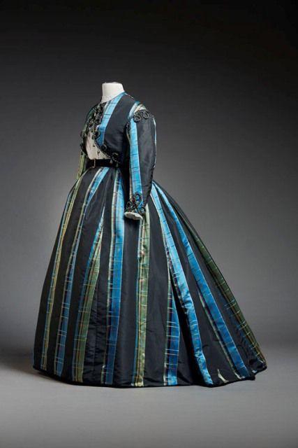 Mid-1860s plaid silk skirt and jacket trimmed with braid and bobbles. Musée du Costume et de la Dentelle, Brussels.