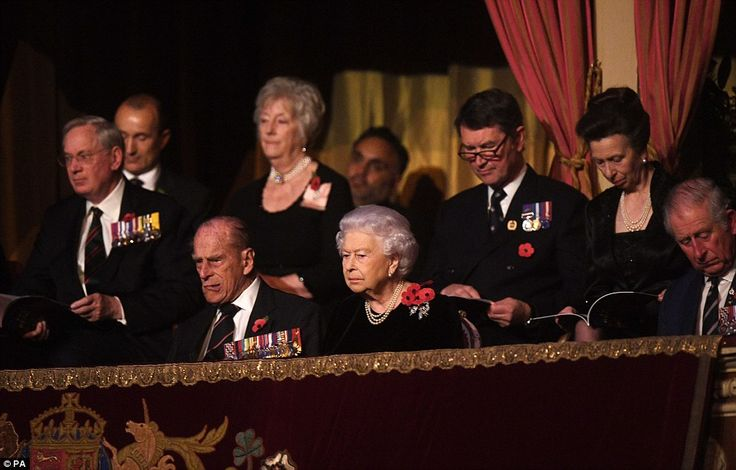 The Queen and Prince Philip are seen watching the show intently while the Princess Royal, Sir Tim Laurence and the Prince of Wales browse the programmes