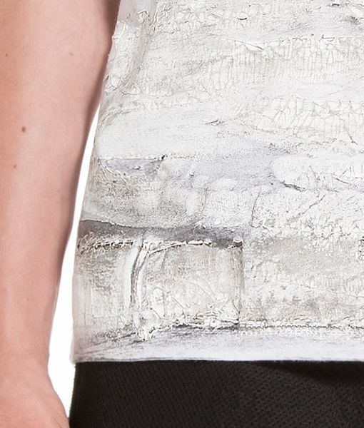 Plaster T-shirt detail by Stefano Lo Muzio for TX3. Model: Anastasia Popelysheva Photographer: Paola Pansini bit.ly/1fXSClv Attracted by the everyday surroundings, I designed this garment inspired by Gilles Clément's uncertain places: abandoned urban fringes and underused areas which tell stories of the circumstances which determined their decay and recall memories of the people who lived them.