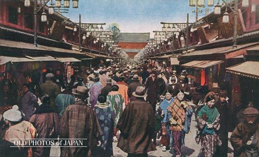 1920's, Tokyo. Asakusa Nakamise. The Nakamise souvenir shops at the Buddhist temple Senso-ji in Asakusa, Tokyo. In the back the huge Niomon (仁王門) entrance gate can be seen. The first shops were built on this location in 1885 (Meiji 18).