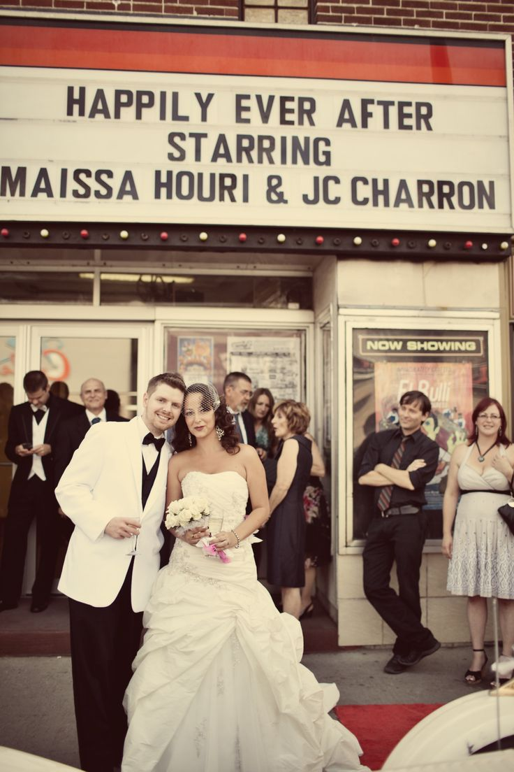 Our names on the marquee -movie theatre wedding