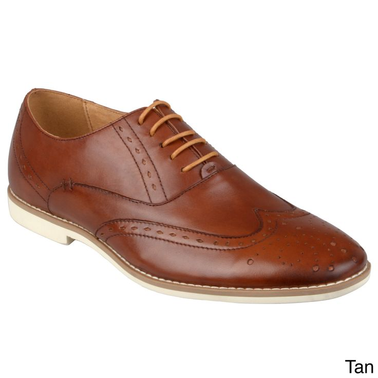 E105 Create polished style with these wingtip oxfords by Steve Madden. These handsome shoes are constructed of genuine leather uppers with top-stitching and eyelet detail. Round toes and a classic lace-up design completes the look.