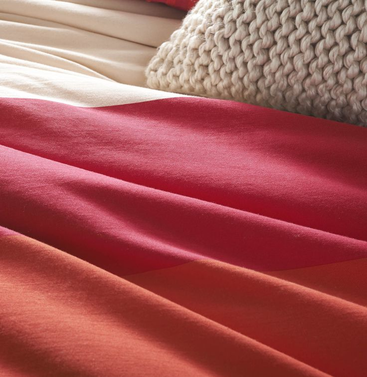Amplify the look of your bedroom with the vibrant DKNY Colorblock Duvet Cover. Dressed in a luscious combination of pink glow, hot coral and neutral, the bright and bold bedding instantly injects a fresh burst of color into your bed.