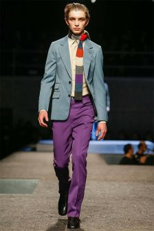 Prada reinterpreted the energy of the 1970s, by using a flamboyant color palette and surprising elements, such as rectangular ties worn as scarves.  More on Milan Fashion Week FW 2014 Menswear collections: http://attireclub.org/2014/01/29/milan-fashion-week/