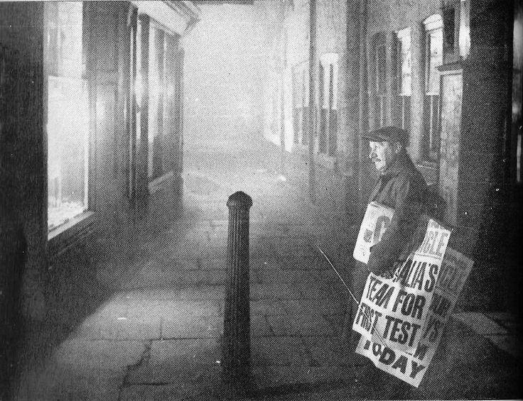 Newspaper seller in the Shambles, 1937, with copies of the Manchester Evening Chronicle, one of two evening papers that were on sale in Manchester for over sixty years.