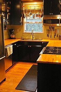 Modern.  Efficient.  Attractive.  ...stand in one place and touch everything! Click for more views. I really like Judy C's cozy living boards. My kitchen is laid out much like this, a bit wider. The U shape is really practical.