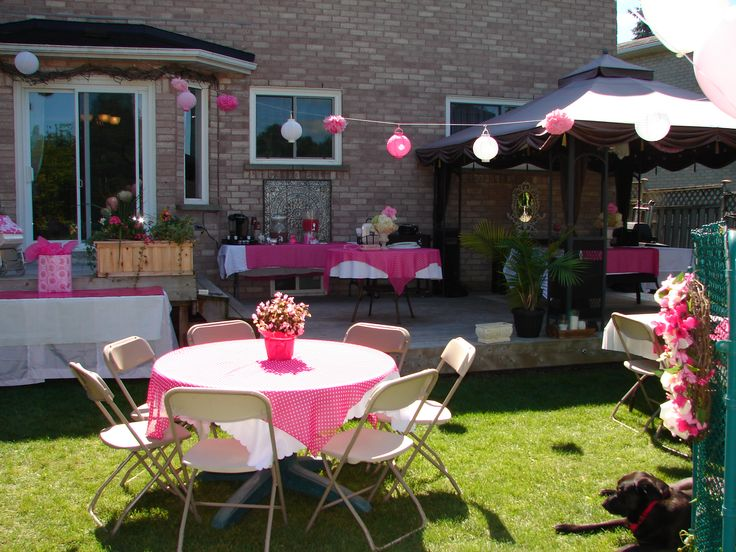 Pink and white polka dot table clothes and pink flowers