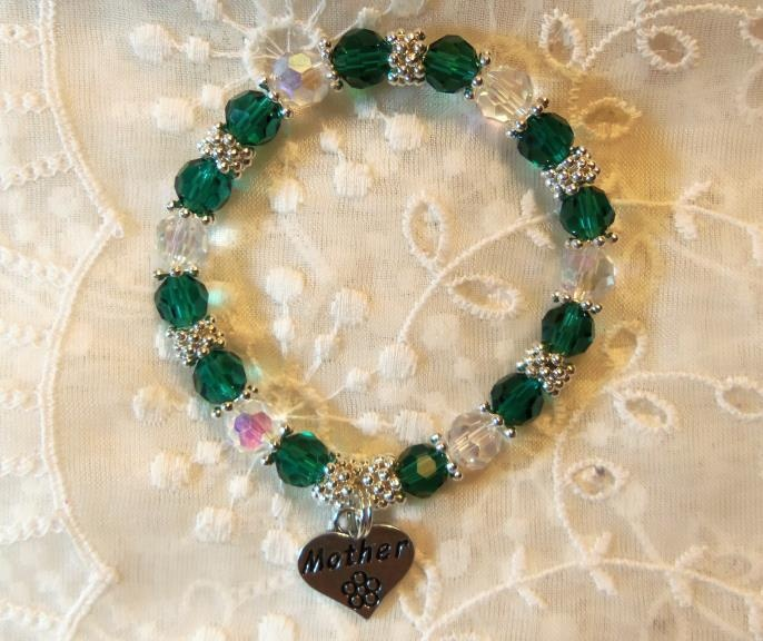 Beautiful green and clear Swarovski crystals. Bracelet I made for a young man to give his mother on Mother's Day. Sweet :)