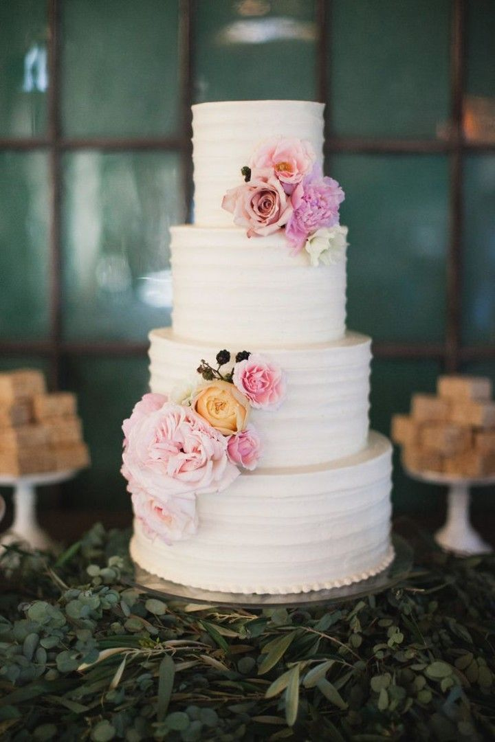 white 4 tier wedding cake with cascading pastel flowers ~  we ❤ this! moncheribridals.com