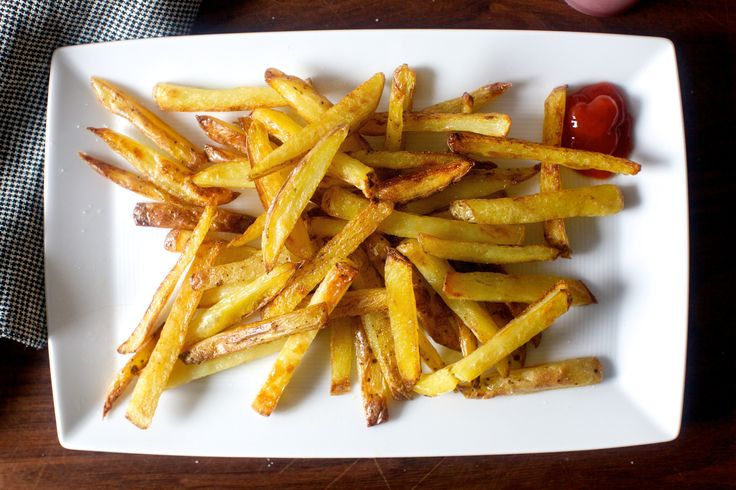 Oven-roasted french fries as close to the golden, crisp and glittery-with-fine-salt ideal as they come.