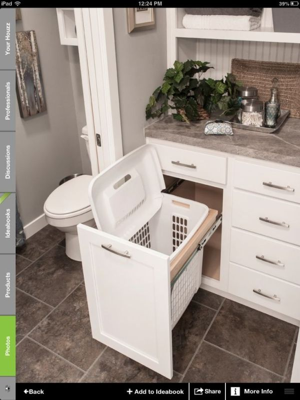 Bathroom idea- hamper storage. Love this idea!  Hamper hidden, great if dogs like to take clothes laying around...