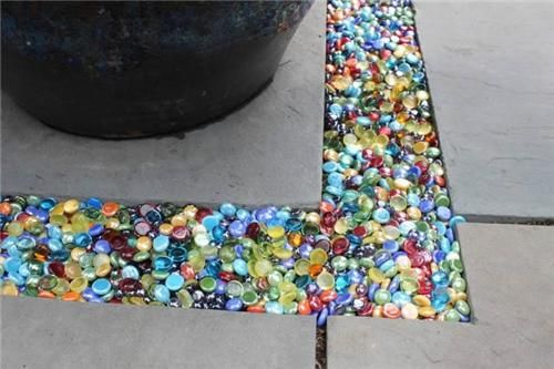 Colored glass Instead of gravel in the garden or patio...you can get these at the dollar store. Neat idea!