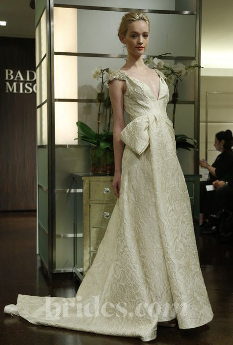 """Brides.com: Badgley Mischka - Fall 2013. """"Ariel"""" silk jacquard ball gown wedding dress with a plunging v-neckline, beaded cap sleeves, and half-bow details at the waist, Badgley Mischka Bride  See more Badgley Mischka Bride wedding dresses in our gallery."""