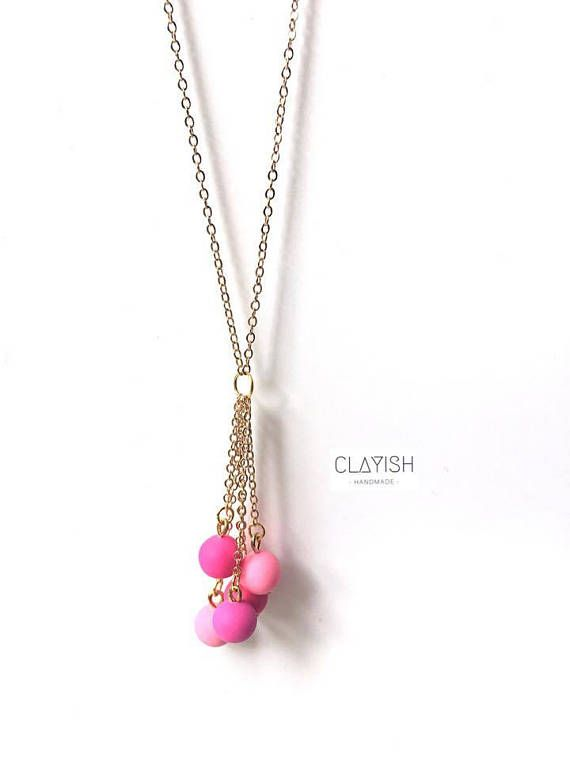 This beautiful combination of pink colour hanging polymer clay will give a special touch to your outfit of the day! Available in pink, however custom order is welcome too! Beads Materials: Polymer Clay Bead Colour: Pink Chain Materials: Copper Chain Colour: Gold/SIlver Length: 46 cm Every piece of the clay is carefully shaped and completed by hand, therefore each of them is unique and there might be little imperfections or occasional fingerprints.
