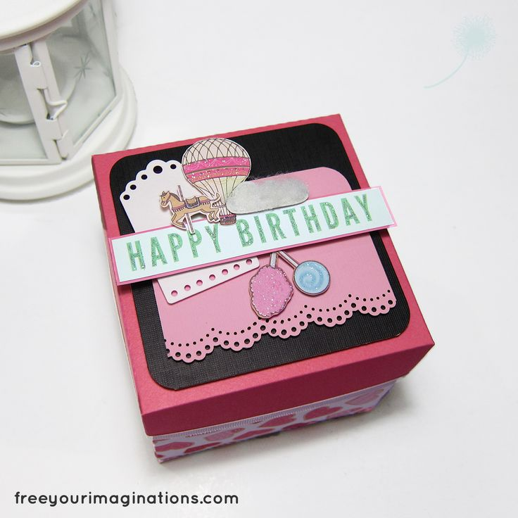 This is Outside View Explosion Box for Girlfriend Birthday titled Candyland with theme Ballon & Carnival Horse Cartoon, and Pink Elegance Theme featuring Rectangular Cake in the middle