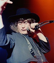 "Noddy Holder  Neville John ""Noddy"" Holder MBE is an English musician and actor. He was the lead vocalist and guitarist with the Rock band Slade.   Born: June 15, 1946 (age 69), Walsall, England Nationality: United Kingdo"