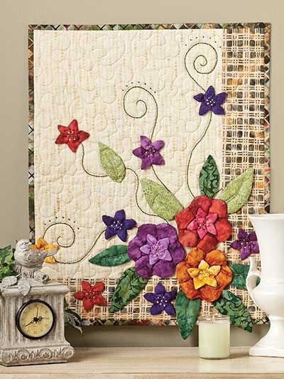 """Explore your creative options with a bit of dimensional applique using scraps. This e-pattern was originally published in Applique Techniques Made Easy. Size: 16"""" x 20"""". Skill Level: Easy"""