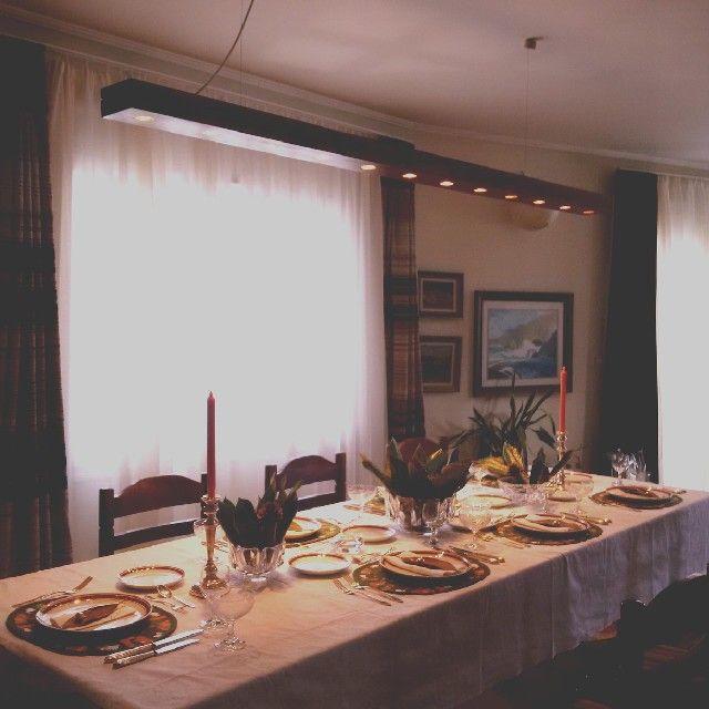 www.facebook.com/MlleZapanti  Winter tablescape  Magnolia and pinecones centerpiece by MlleZapanti