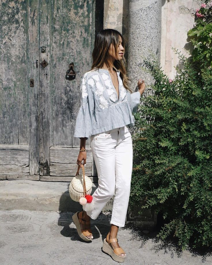 Chic neutral outfit with white pants and wedges