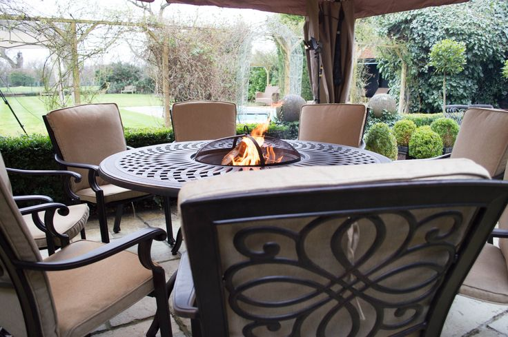 great pic of a Gregg Wallace dining set under a gazebo... http://outsideedgegardenfurniture.co.uk/product-category/cast-aluminium-outdoor-furniture/greg-wallace-firepits/