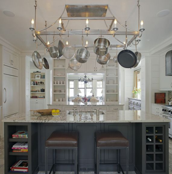 White kitchen with marble table top and hanging pots and pans from Historical Concepts