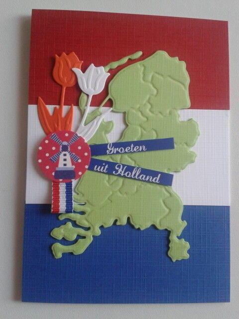Hollandsche kaart met achtergrond de vlag en nederland met tulpen...