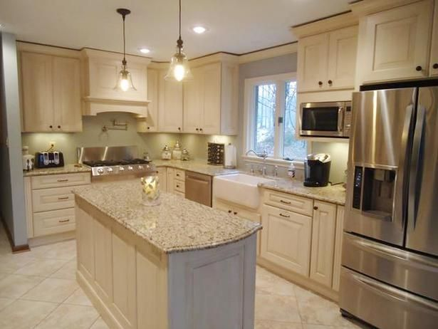 love the counters, but maybe different colored cabinets?