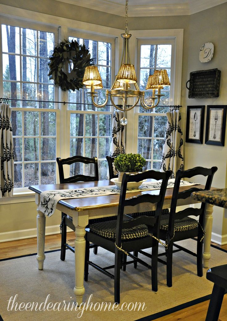 Kitchen Tour.  Like the black chairs with the white distressed table legs.