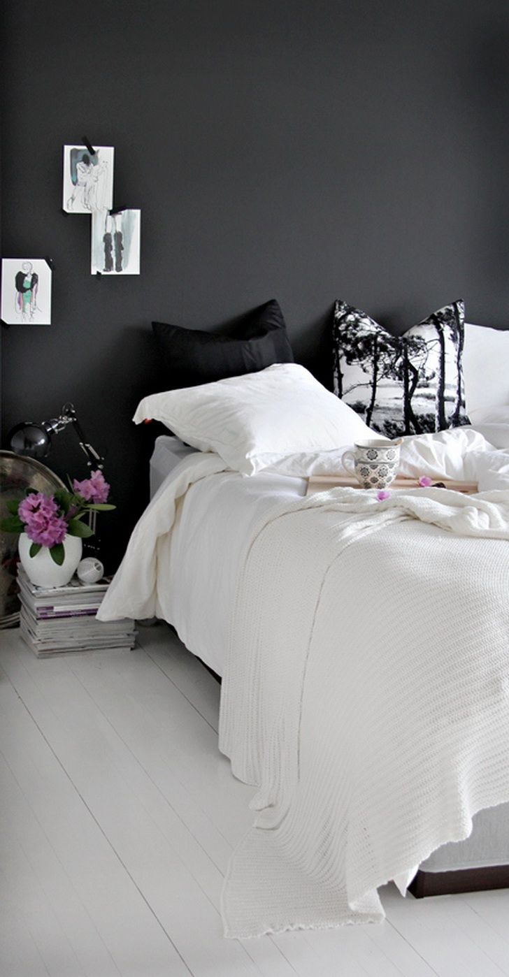 Beautiful contrast between dark nearly black wall and white floor boards