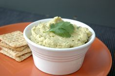 Avocado Hummus combines the flavors of hummus and guacamole. This healthy hummus is oil-free, and loaded with avocados, lime juice, and cilantro. Visit instantlydelicious.com
