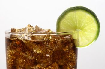Grown up Cuba Libre:  1 1/2 oz light rum  1/2 oz gin  3/4 oz lime juice  2 dashes of angostura  shake  add 3 oz coke. Mmmm.