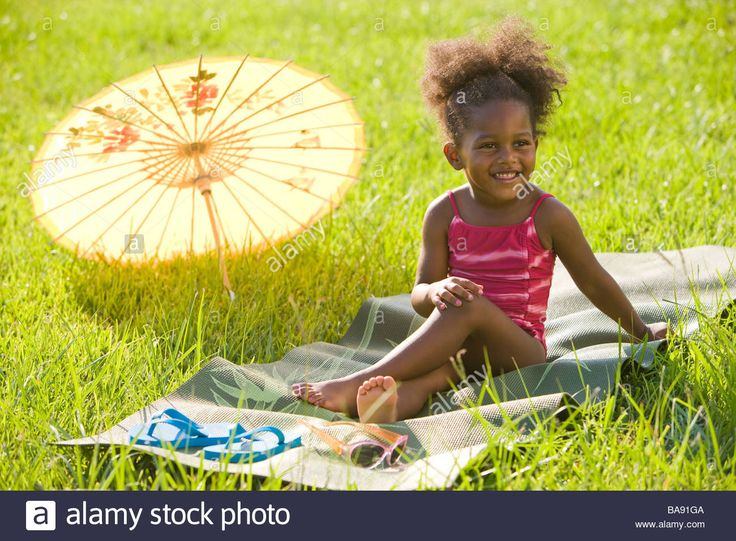 Portrait Of Young African American Girl In Bathing Suit Relaxing ...