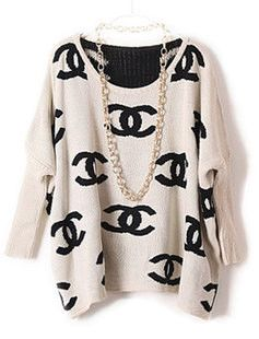 GET HERE: http://www.glamzelle.com/collections/tops/products/chanelesque-reversible-beige-batwing-sweater
