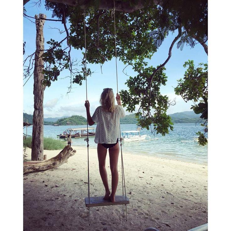 📷 @juliettadipera 'Swinging on the beach #missitalready #beach #giliasahan #lombok #vacation #travel #indonesia #revolveme #revolvearoundtheworld #marysiaswim #tularosa @gili_asahan_eco_lodge 🌴🐚🦀🐠🌎'  #regram #swing #girlsborntotravel #iamatraveller #bikinilife #beachlover #summervibes #islandlife #thesimplethings #travelgram #travelphotography #traveldiaries #exploringtheworld #lifewelltravelled #instamoment #paradise #fun #vacationmode #summertime