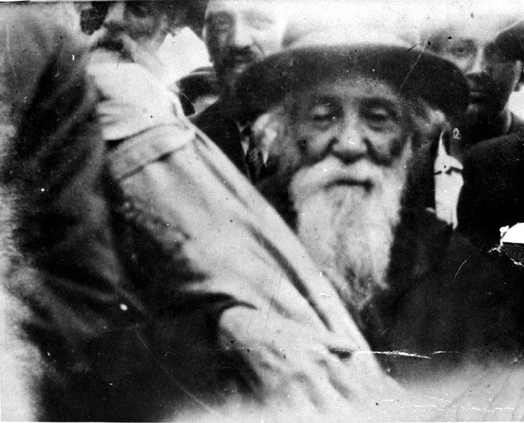 The Rabbi of the City Carrying a Torah Scroll on his Way to a Deportation Train, Iasi, Romania, June 1941
