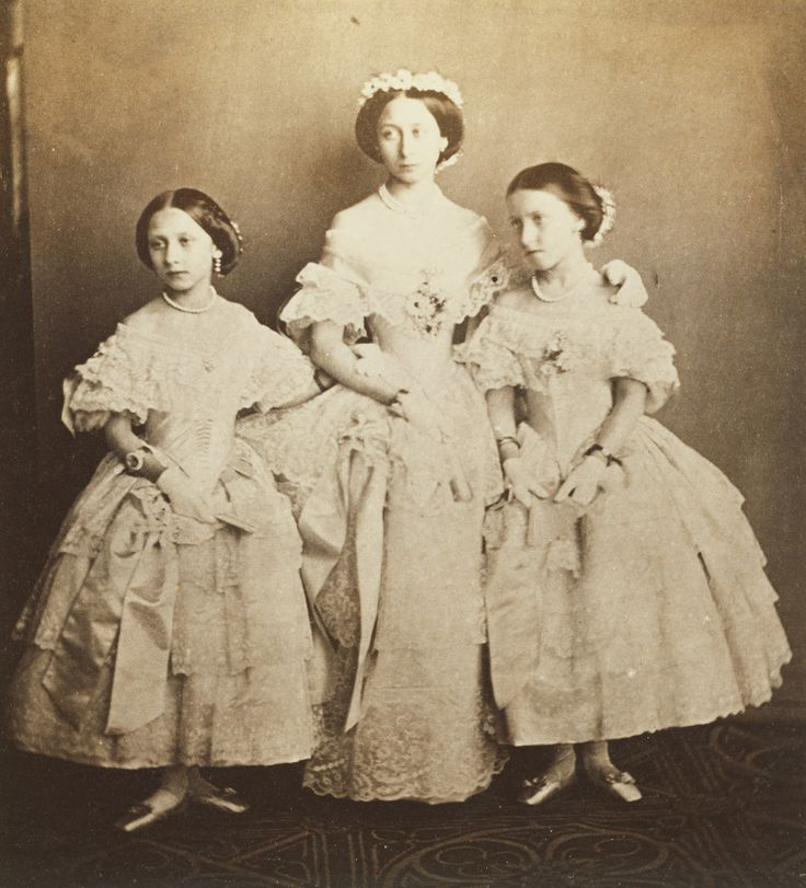 Photograph of Princess Louise, Princess Alice (centre) and Princess Helena in the dresses they wore at the marriage of their eldest sister Princess Victoria, January 25 1858.
