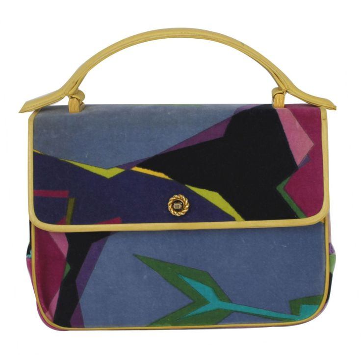 - Vintage handbag with trendy look  - Pucci velvet multicolored handbag  - Fresh combination of blue, violet, pink, green and yellow  - With yellow leather trim  - Single yellow leather handle  - Gold tone clasp closure  - Inside lined in black and yellow leather  - With two side pockets  - Made in Italy