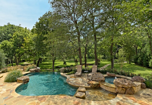 """like flagstone, wading pool, hot tub, infinity edge overlooking wooded landscape""  ""Landscaping idea around the wash""  ""Great poolside...Garden landscaping"""