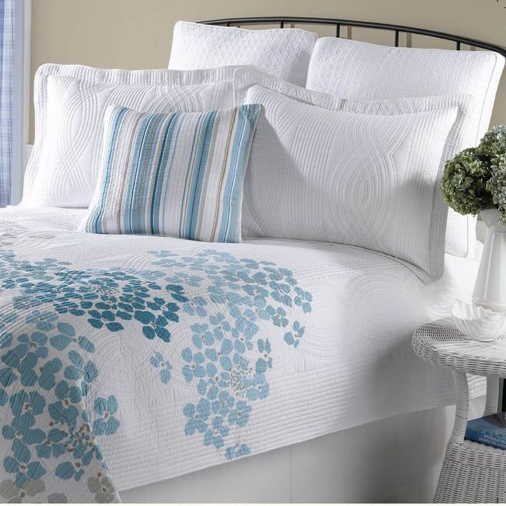With a soft color palette and a contemporary floral print, this three-piece quilt set brings a touch of springtime to your bedroom. The quilt's cotton fill provides just enough warmth, and its durable microfiber shell maintains its good looks over time. This attractive set is machine washable for easy care.