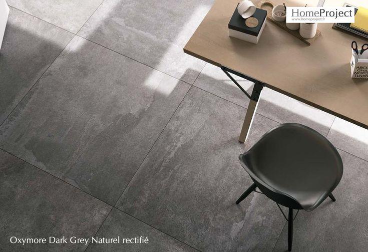 Carrelage aspect béton brut très contemporain de couleur gris anthracite, en grès cérame teinté dans la masse disponible en format 90x90 cm.