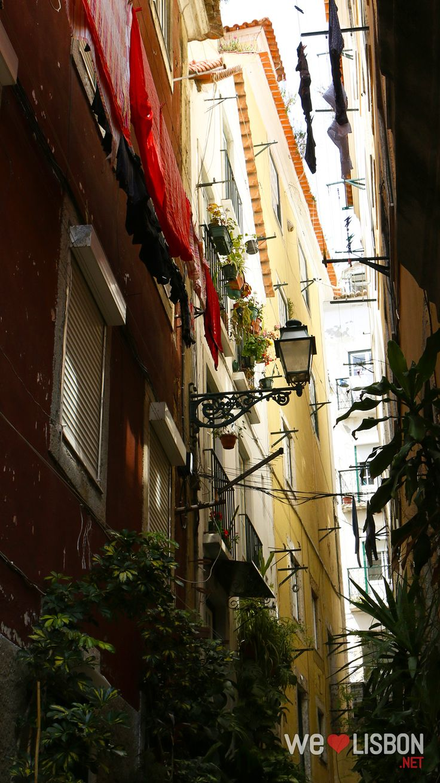 Narrow alley in Alfama neighbourhood - Lisbon