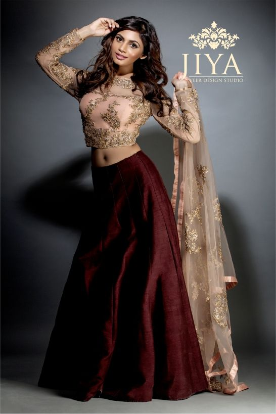 A peach  crop top with taar embroidery styled with a stunning burgundy silk skirt and embroidered dupatta.  We love the sexy back, do you ?