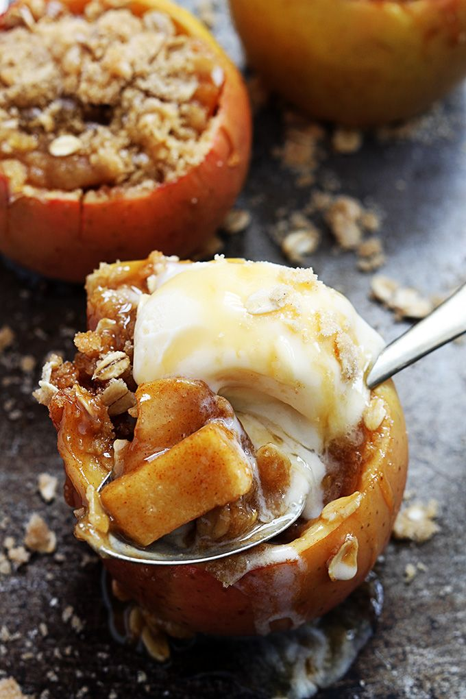 Easy cheesecake stuffed baked apples topped off with caramel sauce, graham crackers and pecans! This no-fuss treat is the ultimate Autumn dessert!