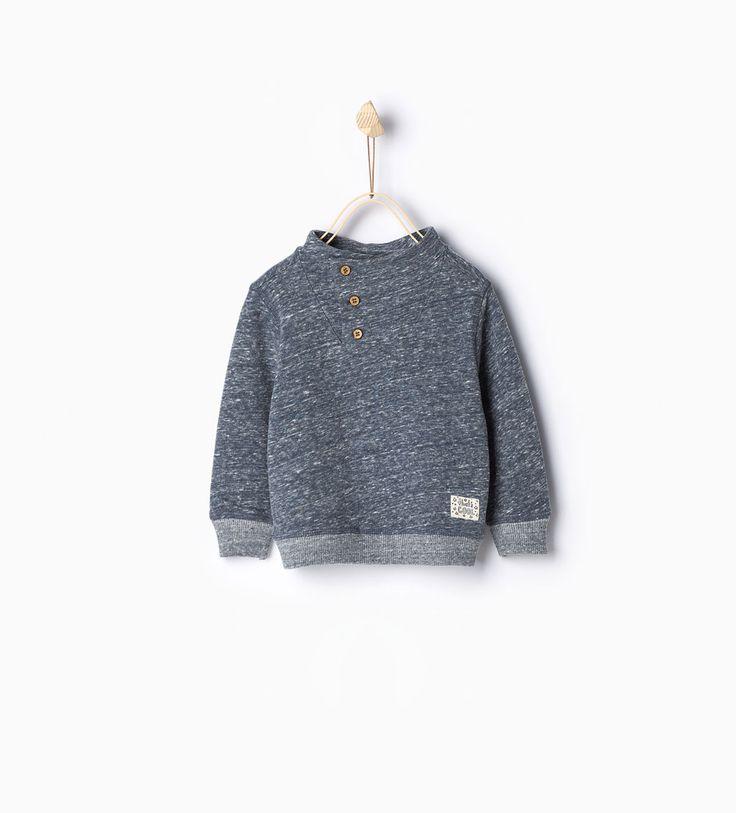 Imagem 1 de Sweatshirt botões e cotoveleiras da Zara