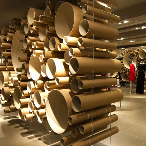 Exhibitors who sell non-glamorous items (like cardboard tubes) often say they can't have an exciting booth display ... well just look at this inspiration that displays repetitive items like a work of art! - John Lewis Pavillion by Grimshaw