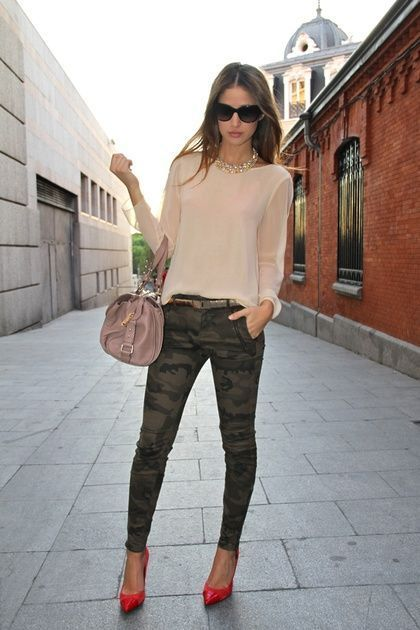 Shop this look on Lookastic: https://lookastic.com/women/looks/long-sleeve-blouse-skinny-jeans-pumps-satchel-bag-sunglasses-necklace/12717 — Black Sunglasses — Gold Necklace — Beige Long Sleeve Blouse — Beige Leather Satchel Bag — Dark Green Camouflage Skinny Jeans — Red Leather Pumps