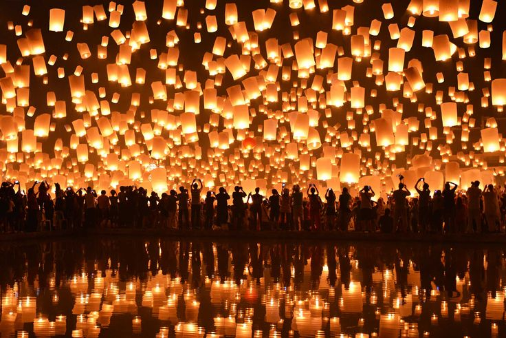 Lighting up the sky | Nanut Bovorn | Lanterns soar up into the sky—and they're also reflected below—as part of the Loy Krathong festival, which usually takes place at the end of the rainy season, in Thailand. The lanterns are released to protect against bad luck.